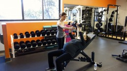 MBS Personal Trainer, Tatum Rebel guides a prenatal client through a supported arm press