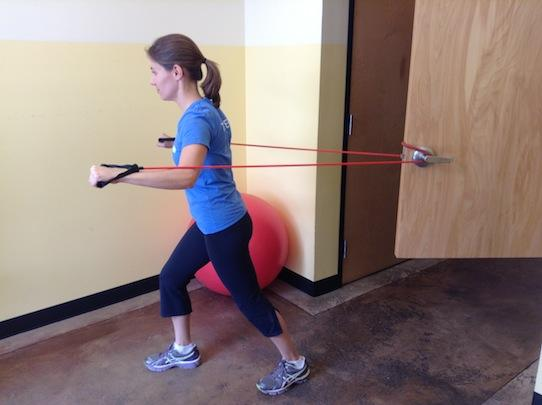 Personal Trainer, Tatum Rebel demonstrates chest press using a resistance band