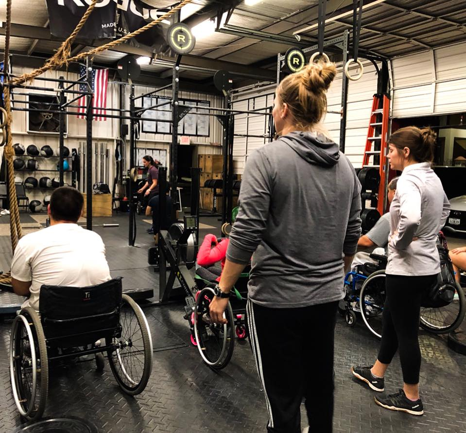 Adaptive Crossfit Members in wheelchairs get ready for a WOD