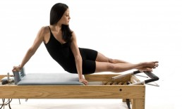 Woman training on Pilates Apparatus